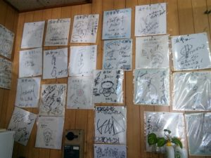 A signature of a celebrity affixed inside the shop of Habu shokudo Picture 1