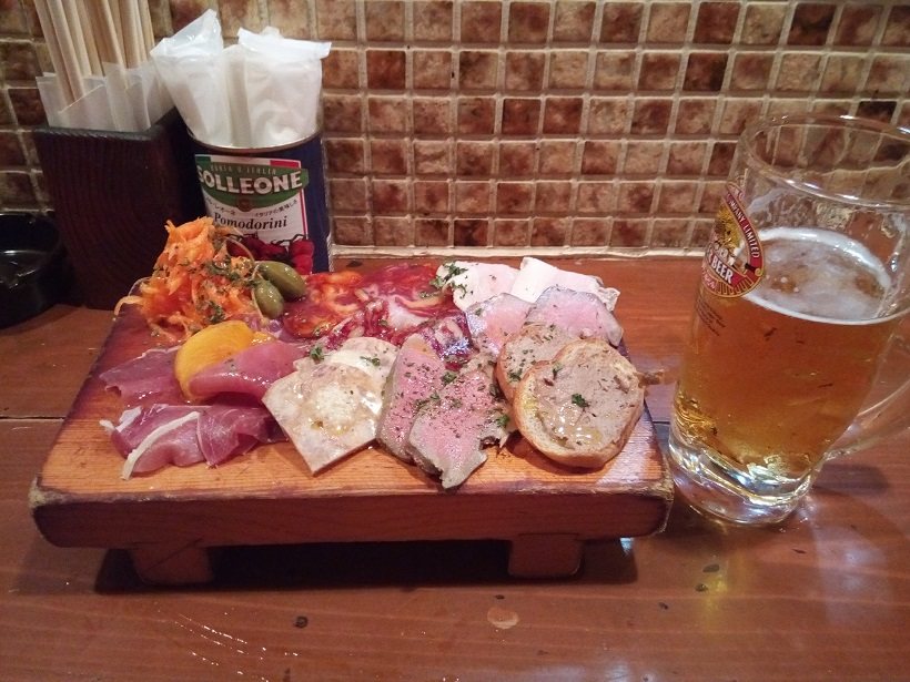 Charcuterie platter and beer