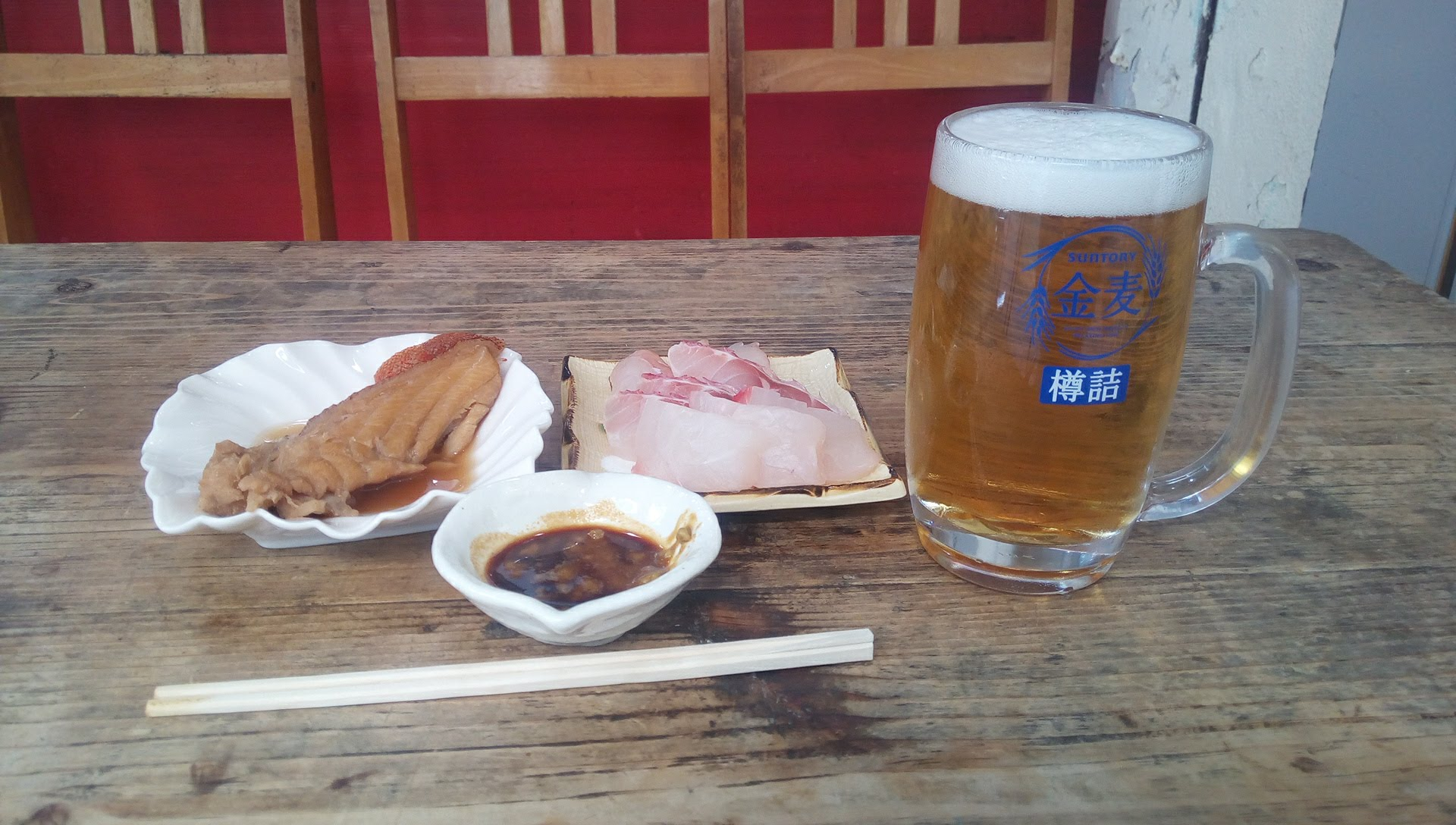fish dishes and raw sashimi and beer