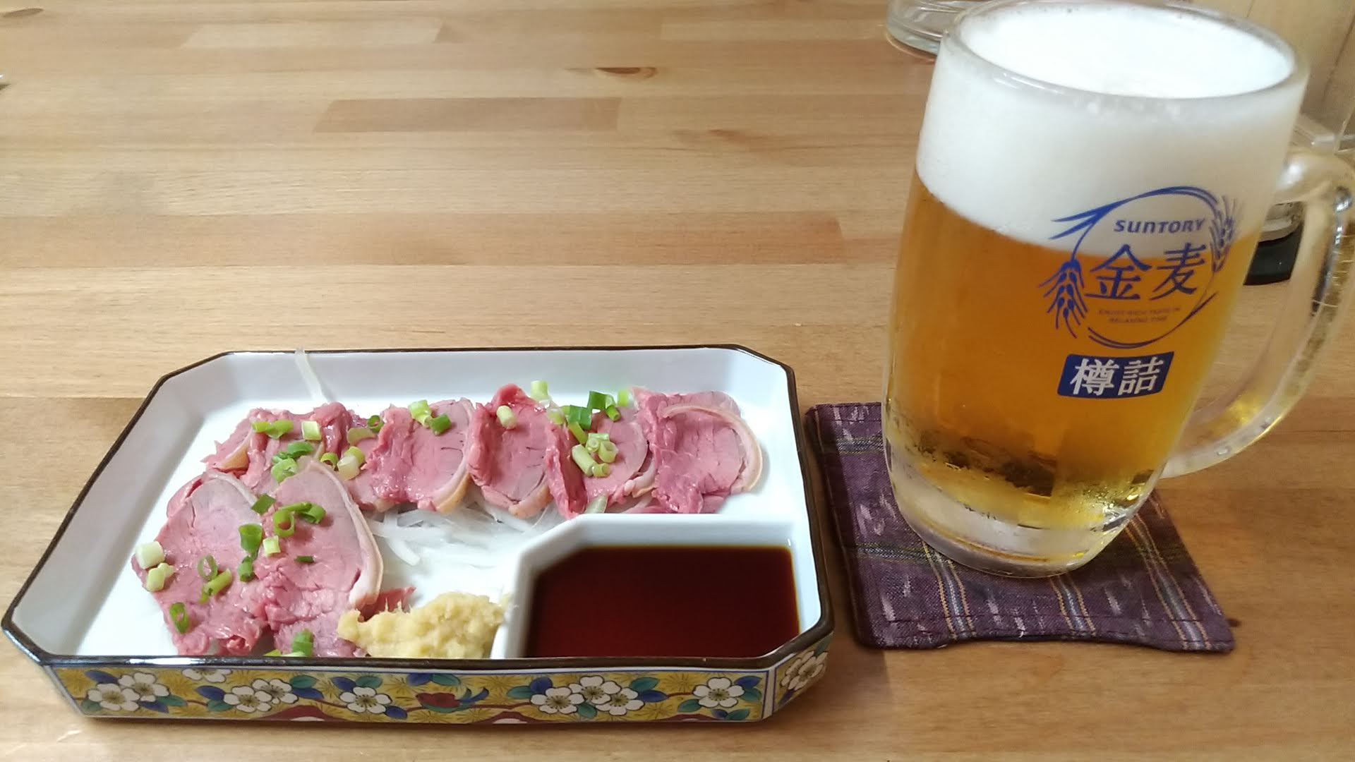 Goat sashimi and beer